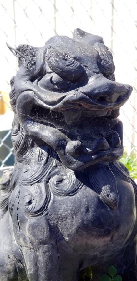 Gardien chinois noir Lion Ornamental Statue photographie stock libre de droits