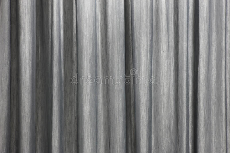 Gardinbakgrundsdetalj med vågor i svartvitt arkivfoton