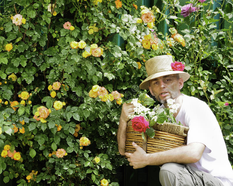 Gardner with straw hat and roses in basket