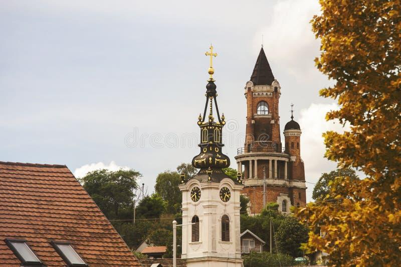 Gardos Tower and orthodox church in Zemun,Serbia. Gardos Tower and orthodox church with autumn colors in Zemun,Serbia royalty free stock photos