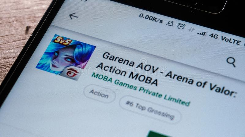 Magelang, Central Java, Indonesia, April 16, 2019. Garena AOV- Arena of Valor app in play store. close up on the Android Smartphon. Garena AOV- Arena of Valor stock photo
