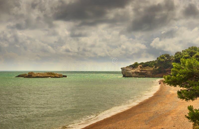 Summertime.Gargano coast: Baia di Campi beach,Vieste-(Apulia) ITALY-The pebbly beach is a picturesque bay sheltered the stock photo