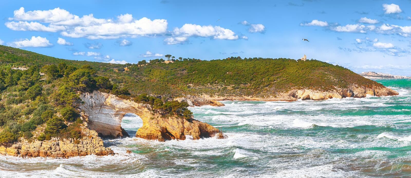 Gargano coast: San Felice arch Architello. Vieste, San Felice arch rock bay, Gargano peninsula, Apulia, southern Italy, Europe royalty free stock photo