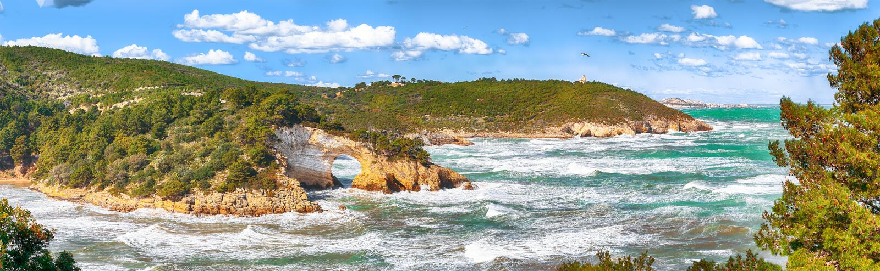 Gargano coast: San Felice arch Architello. Vieste, San Felice arch rock bay, Gargano peninsula, Apulia, southern Italy, Europe royalty free stock photos