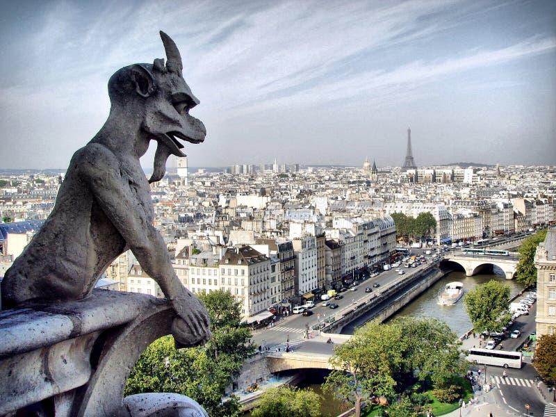 Gargouille. A gargoyle stands guard over Notre-Dame de Paris stock images