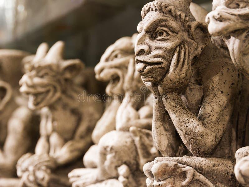 Gargouille Monsterы Souvenirs. Funny Notre Dame Gargouille Monsters, ceramic souvenirs on the desk at a souvenir shop in Paris for sale royalty free stock image
