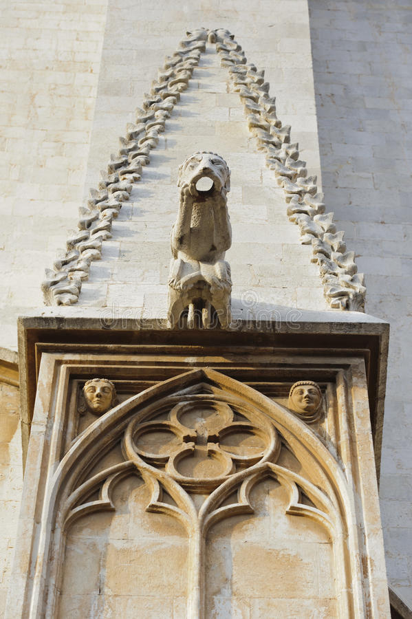 Gargoyle detail on the temple in Tarragona royalty free stock photo