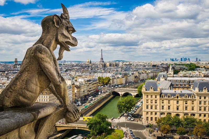 Gargoyle on Notre Dame with skyline of Paris royalty free stock photos