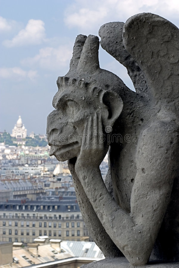 Gargoyle on the roof of Notre-Dame, Paris cathedral royalty free stock photography