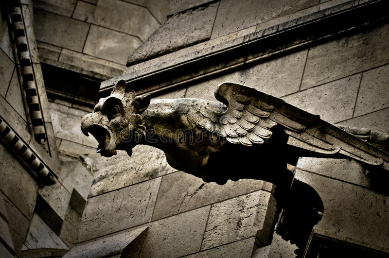 Gargoyle on Sacre Coeur Basilica. In Paris, France stock photo
