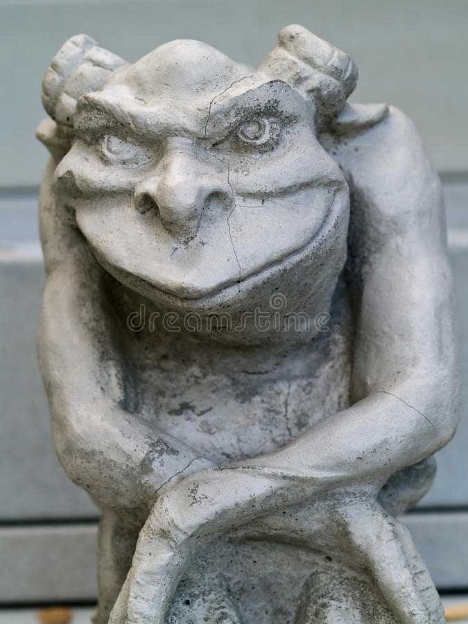 Gargoyle Statue. Taken with emphasis on face and eyes royalty free stock image