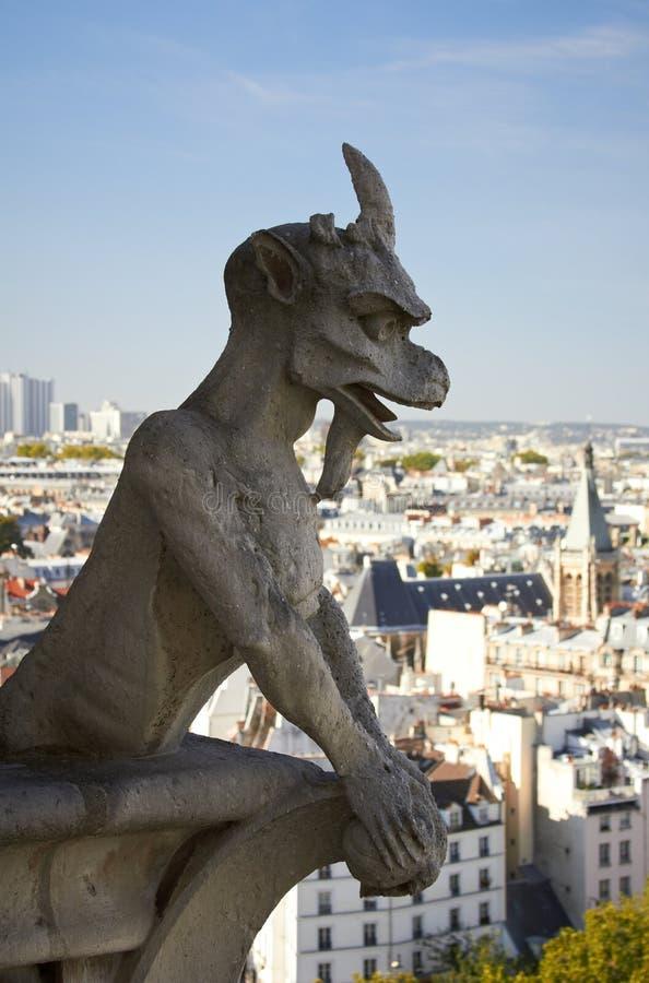 Gargoyle and view from Notre Dame de Paris stock photography