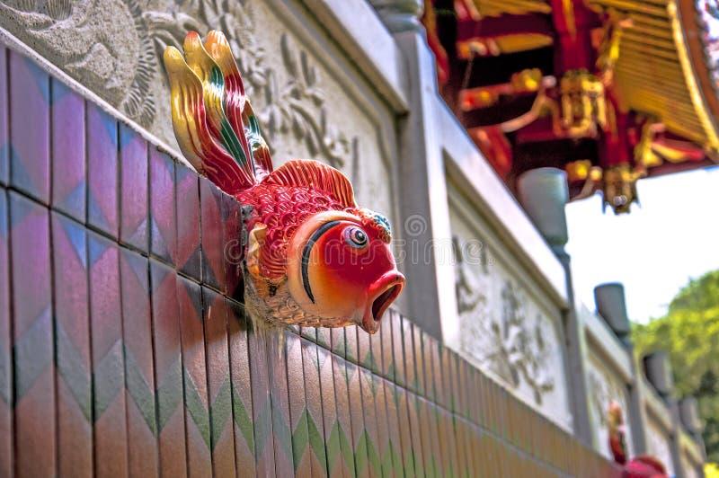 Gargoyles, κόκκινο, κεραμικό γλυπτό, τεχνολογία, πολιτισμός και τέχνη και τέχνη, βιοτεχνίες, παραδοσιακός πολιτισμός και ιστορική στοκ φωτογραφία