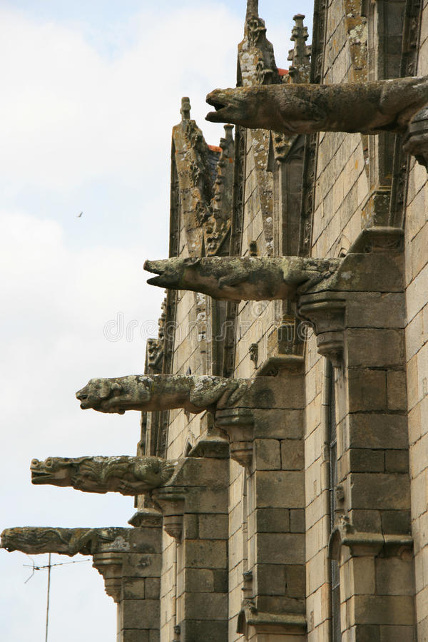 Gargoyles decorate the facade of a basilica (France). Gargoyles decorate the facade of Notre-Dame-du-Roncier basilica in Josselin, France, on May 21, 2009. Des royalty free stock images