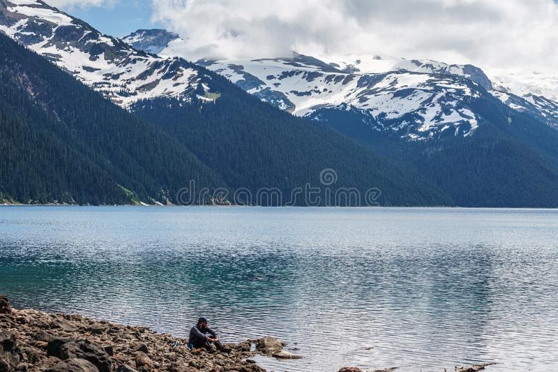 Garibaldi Provincial Park, CANADA - JUNE 16, 2019: view at the lake beautiful sunny morning with clouds on bluew sky. Garibaldi Provincial Park, CANADA - JUNE stock image