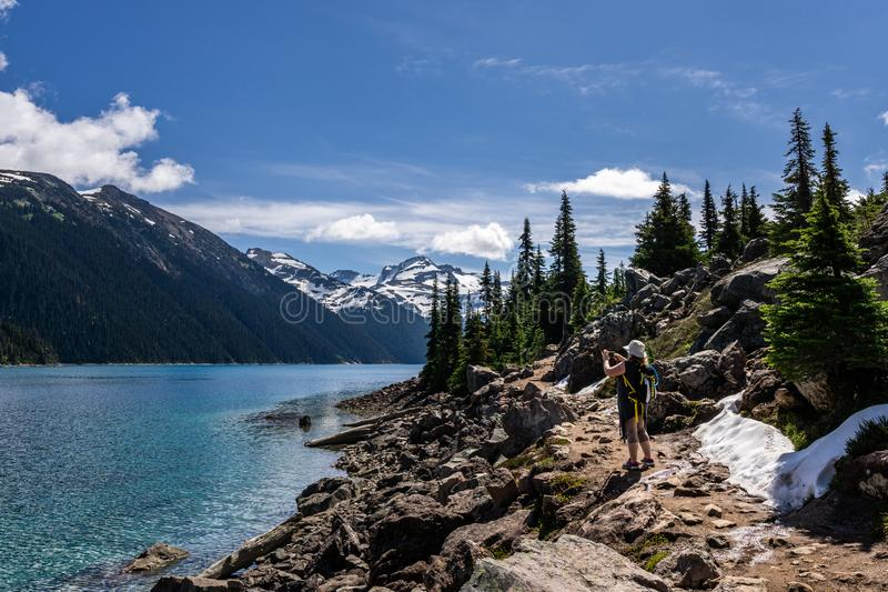 Garibaldi Provincial Park, CANADA - JUNE 16, 2019: view at the lake beautiful sunny morning with clouds on bluew sky. Garibaldi Provincial Park, CANADA - JUNE royalty free stock image