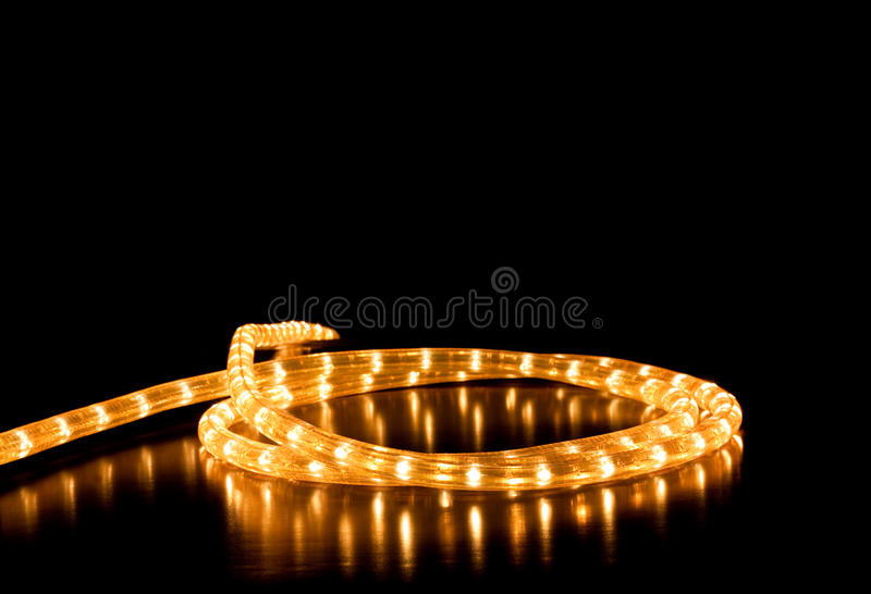 Garland. Glowing garland on black background royalty free stock photography