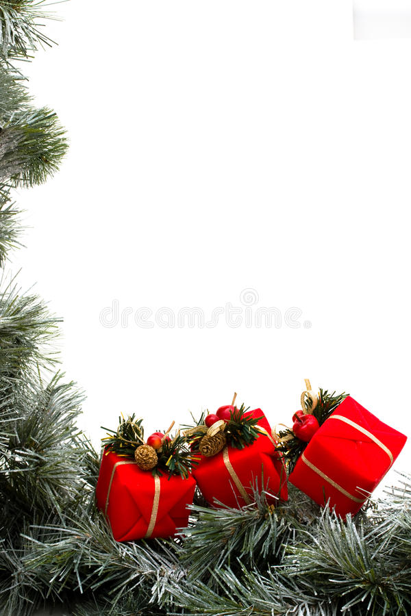 Garland Border. A green garland border with Christmas presents isolated on a white background, garland border royalty free stock photo