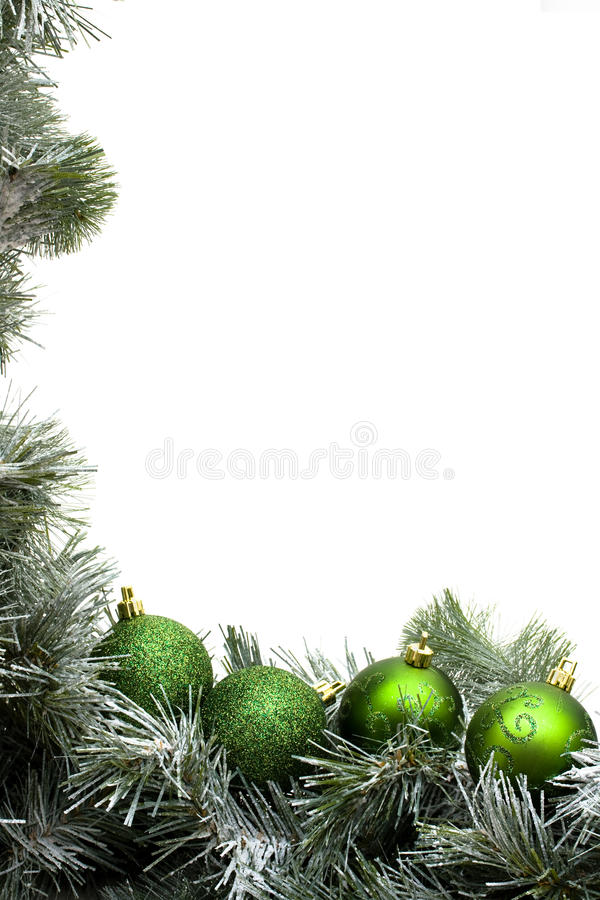 Garland Border. A green garland border with Christmas balls isolated on a white background royalty free stock images