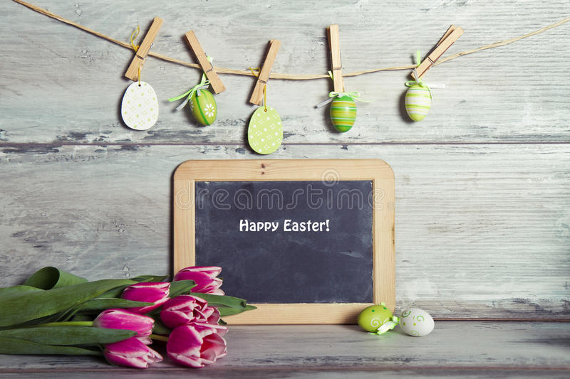 Garland decorated eggs, and blackboard for message royalty free stock photography