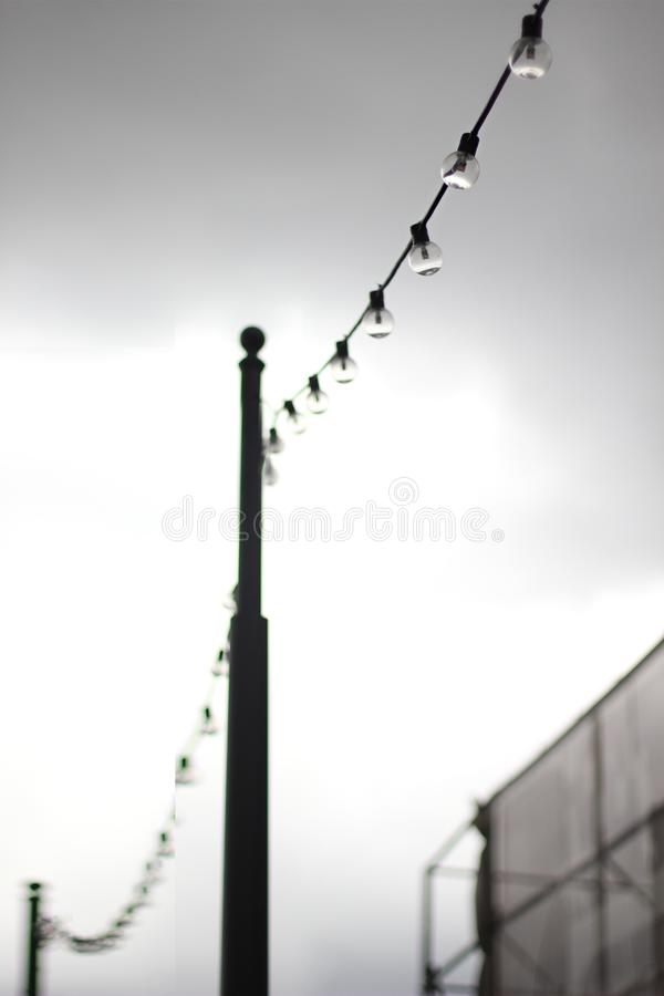 Garland of festive lamps against the sky. Photo with depth of field royalty free stock photos