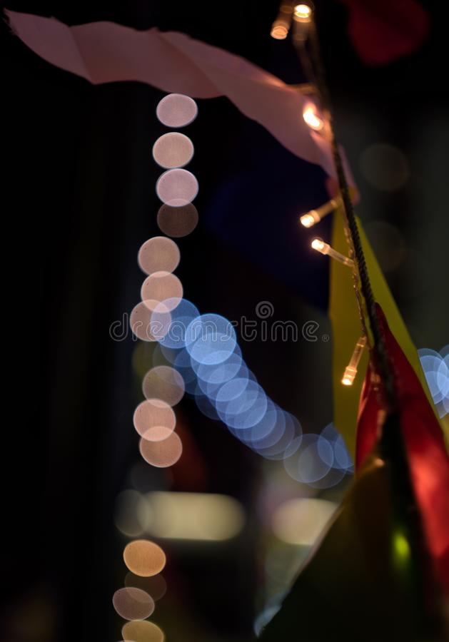 Garland and flags at the night. Decoration of colorful flags and garlands at the night street stock images