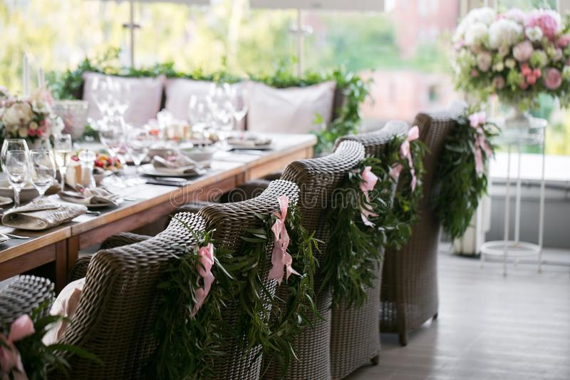 Garland of flowers and greenery for table decoration. Luxury wedding reception in restaurant. Stylish decor and adorning stock photos