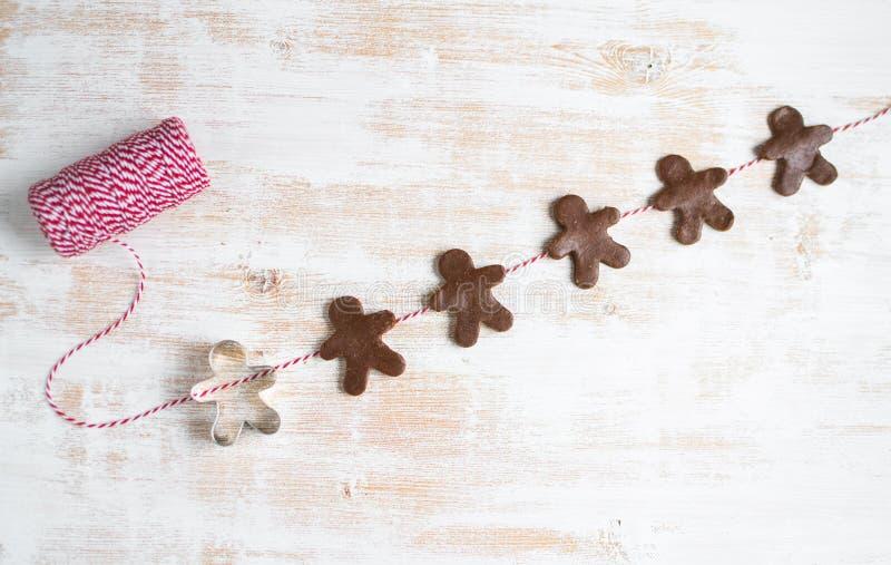 Garland Gingerbread Man Red Yarn Fir Tree Brunch Dough Christmas Concept. New Year Party stock photos