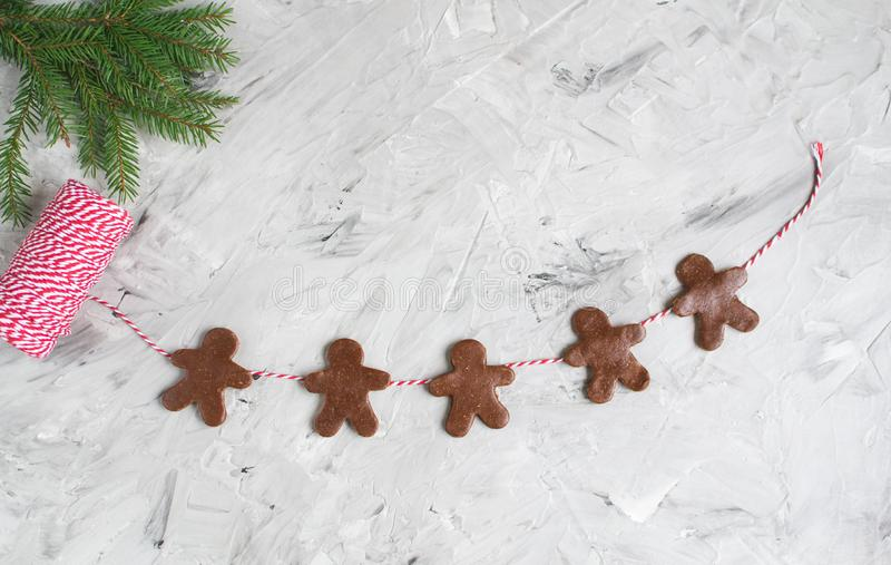 Garland Gingerbread Man Red Yarn Fir Tree Brunch Dough Christmas Concept. New Year Party royalty free stock photos