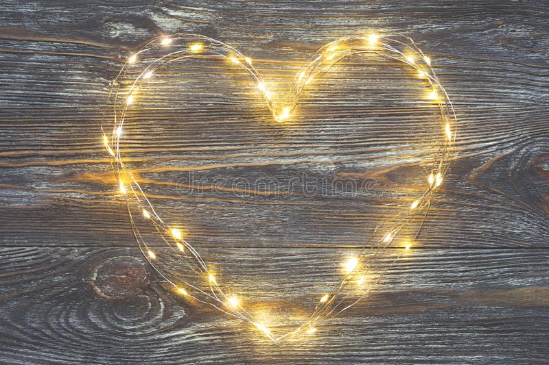 Garland lights in the shape of a heart. royalty free stock image