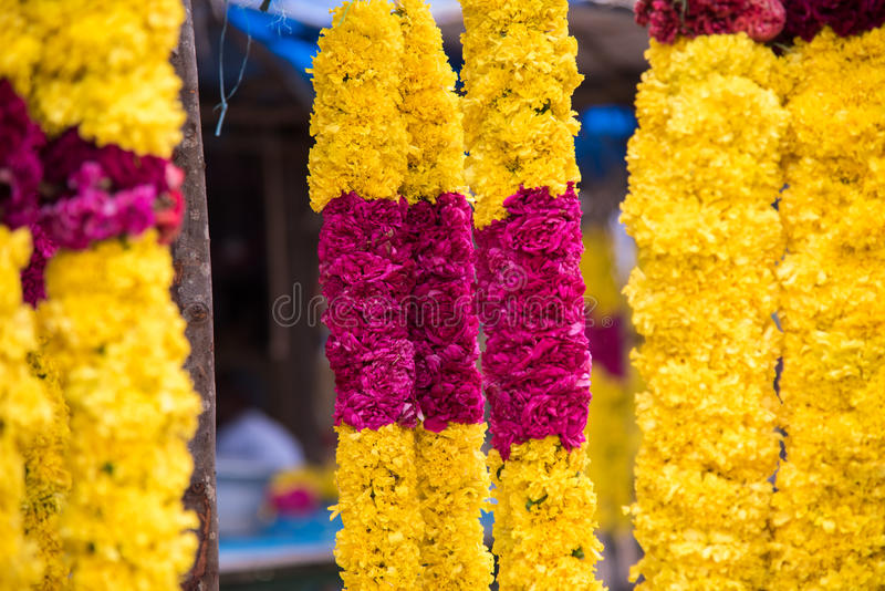 Garland of marigold combined with rose in the market. stock photos