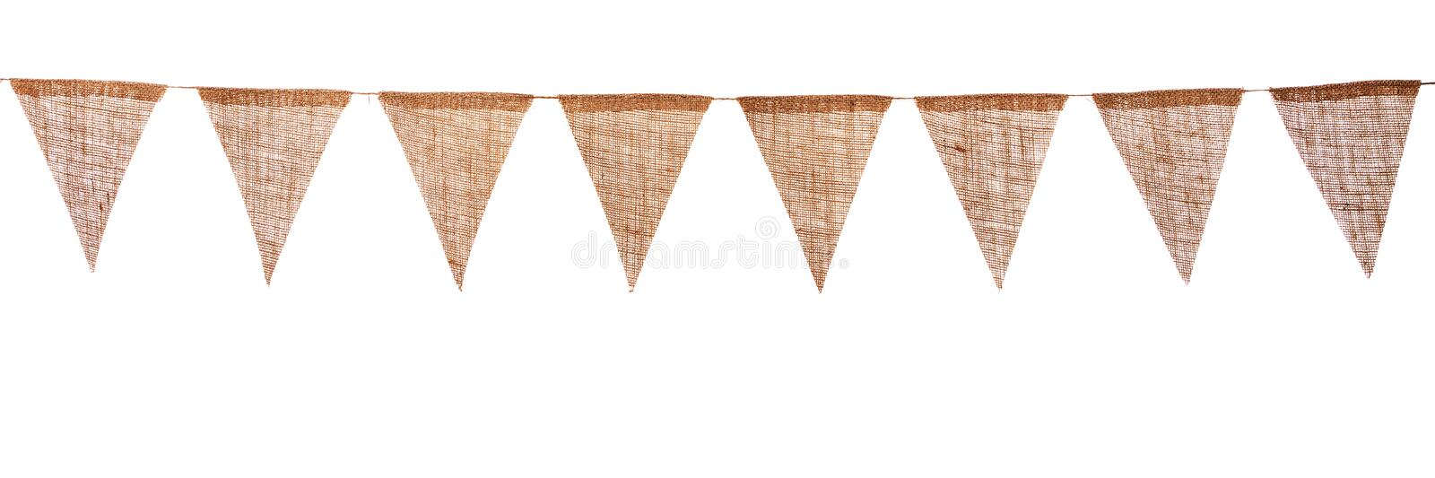 Garland with pennants. Garland with burlap pennants, isolated in front of white royalty free stock photos
