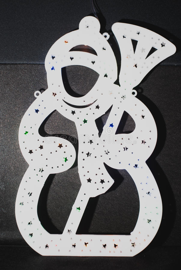 Garland in the shape of a snowman,. Garland in the shape of a snowman on a black background, Christmas ornament royalty free stock image
