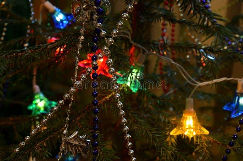 Garland shines on the tree. Christmas. royalty free stock photos
