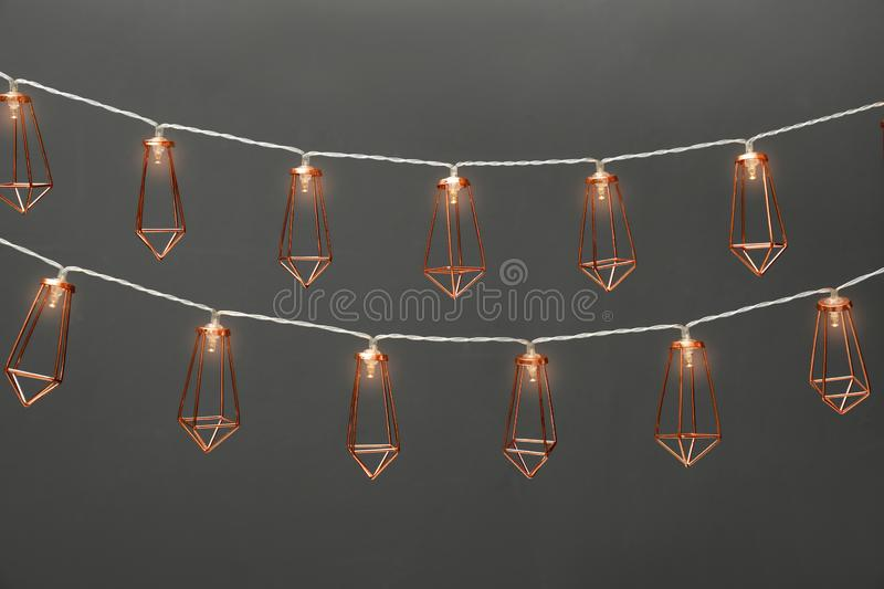 Garlands of lamps with light bulbs. On grey background stock photos
