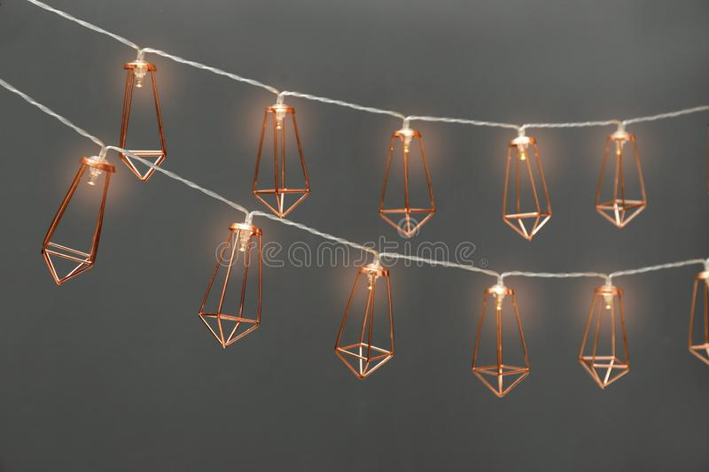 Garlands of lamps with light bulbs. On grey background royalty free stock images