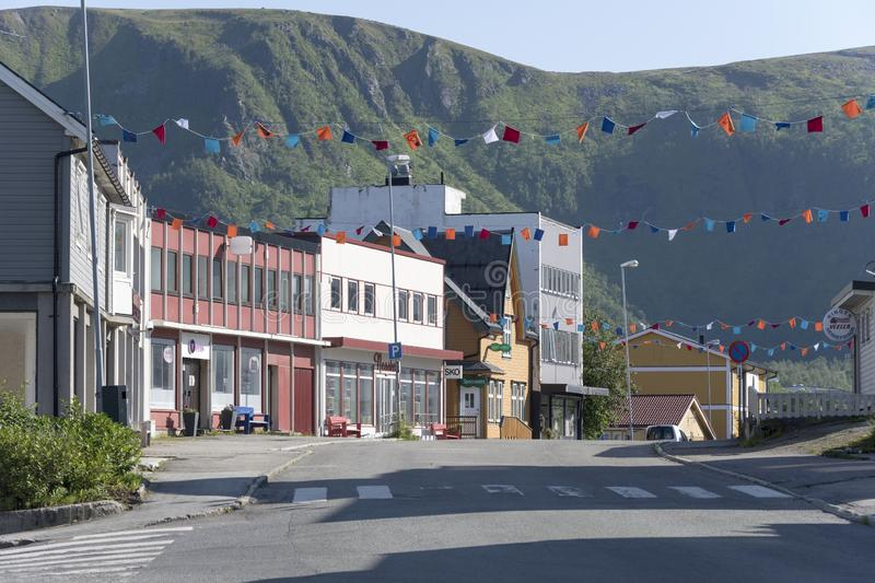 Garlands on town street at Stokmarknes, Norway. STOKMARKNES, NORWAY - July 08 2019: cityscape of little town with garlands in street, shot on july 08, 2019 under royalty free stock photo