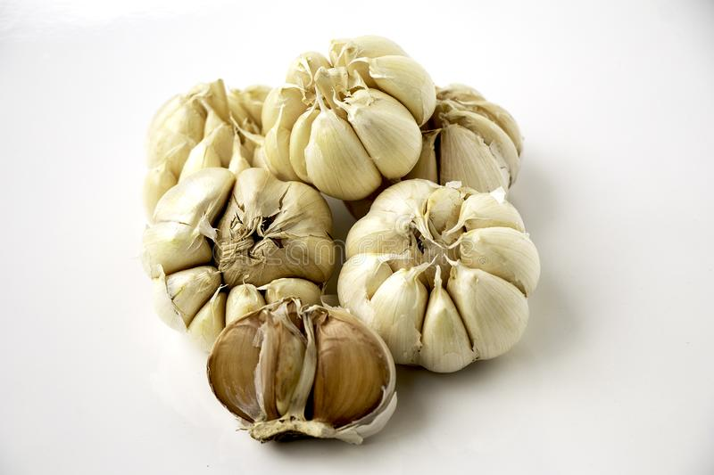 Garlic on white background Group together. Raw materials used for cooking royalty free stock image