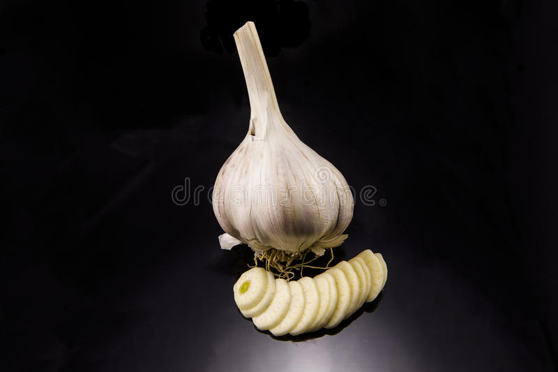 Garlic. Acrid,rn Background,rn Food,rn Fresh,rn Garlic,rn Healthy,rn Herb,rn Ingredient,rn Natural,rn Nourishment,rn Peeling,rn Plant,rn Raw,rn Ripe,rn Seasoning royalty free stock photo