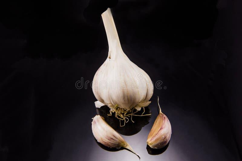 Garlic. Acrid,rn Background,rn Food,rn Fresh,rn Garlic,rn Healthy,rn Herb,rn Ingredient,rn Natural,rn Nourishment,rn Peeling,rn Plant,rn Raw,rn Ripe,rn Seasoning royalty free stock images