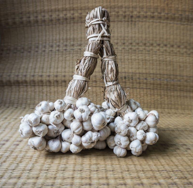 Garlic as woven background stock photo