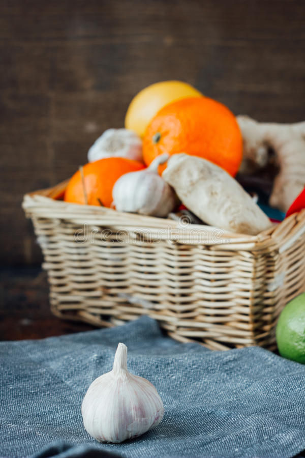 Garlic behind the basket with fruits. And vegetables royalty free stock photo