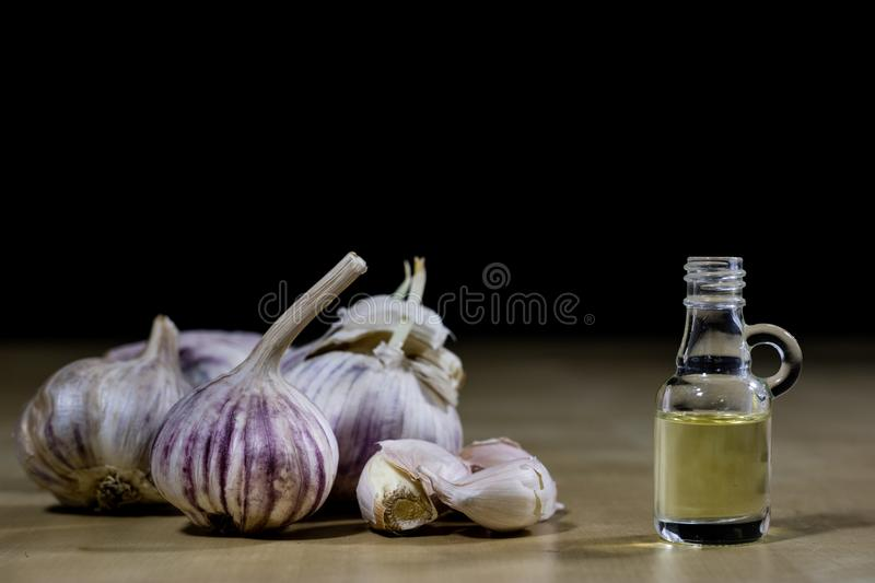 Garlic the best specific for influenza. Syrup prepared from heal. Thy garlic. Black background stock photo