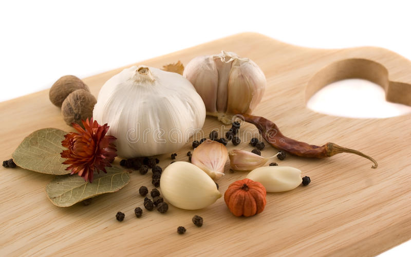 Garlic with black pepper and herbs stock image