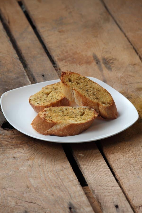 Garlic Bread. Three pieces of garlic bread in plate royalty free stock image