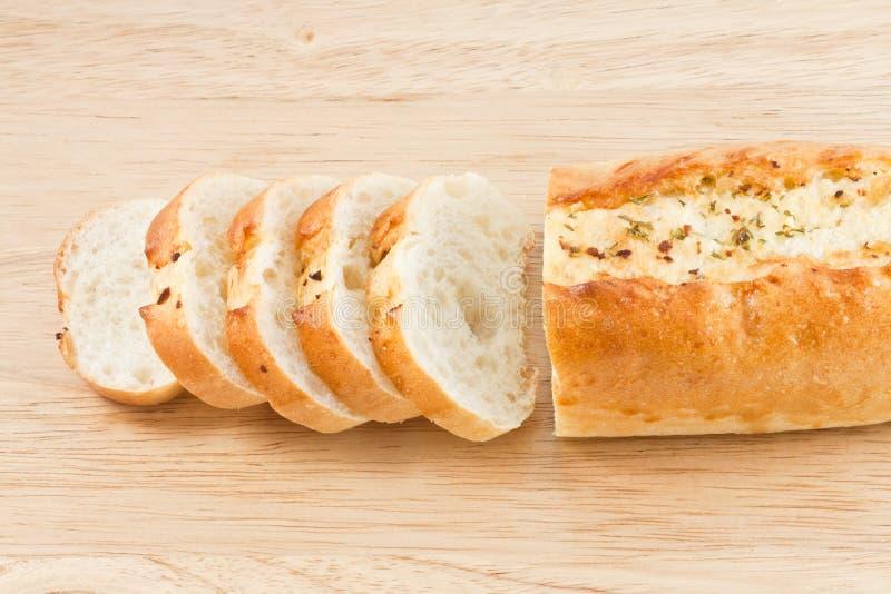 Garlic bread. Cutted Garlic bread on wood cut board royalty free stock photo