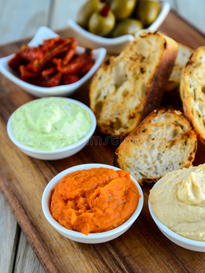 Garlic Bread with mayo olives and avocado. Dip with herbs chilly olives stock image