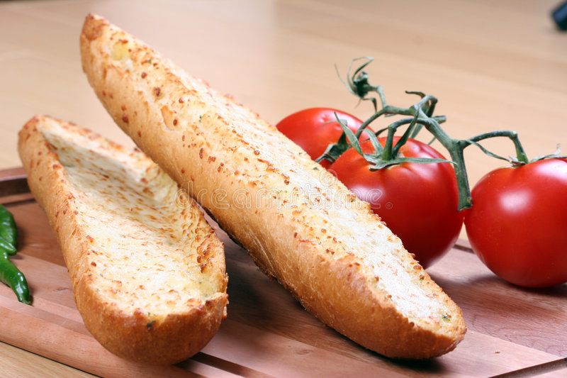 Garlic Bread And Tomatoes Royalty Free Stock Image