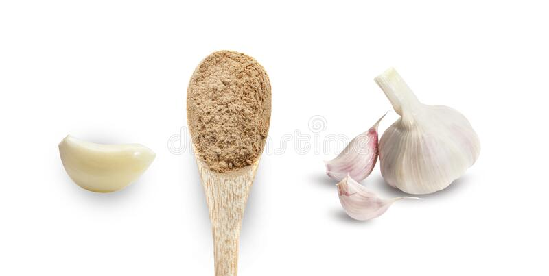 Garlic clove, dry spices in wooden spoon a whole head of garlic. Garlic clove, dry spices in wooden spoon, a whole head of garlic. Isolated on white background royalty free stock photo