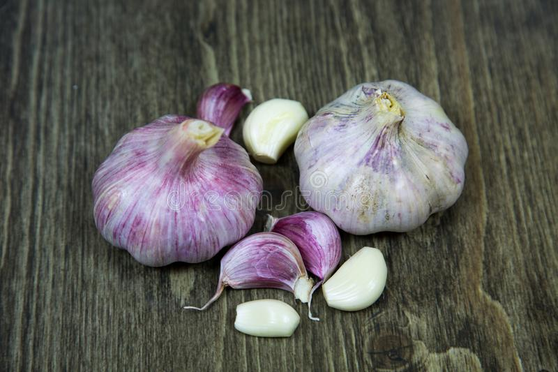 Garlic cloves on a black wooden table background. royalty free stock photography